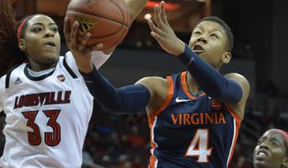 Virginia guard Dominique Toussaint (4) goes in for a layup past Louisville forward Bionca Dunham (33) during the first half of an NCAA college basketball game in Louisville, Ky., Thursday, Jan. 17, 2019. (AP Photo/Timothy D. Easley)