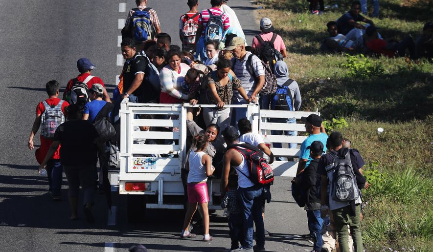 Central American migrants, part of the caravan hoping to reach the U.S. border, move on a road in Tapachula, Chiapas State, Mexico, Friday, Jan. 18,2019. Hundreds of Central American migrants are walking and hitchhiking through the region as part of a new caravan of migrants hoping to reach the United States. (AP Photo/Marco Ugarte)