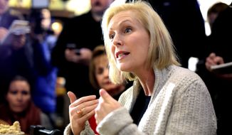 Sen. Kirsten Gillibrand, D-N.Y., meets with residents at the Pierce Street Coffee Works cafe', in Sioux City, Iowa, Friday, Jan. 18, 2019. Gillibrand is on a weekend visit to Iowa, after announcing that she is forming an exploratory committee to run for President of the United States in 2020. (AP Photo/Nati Harnik)