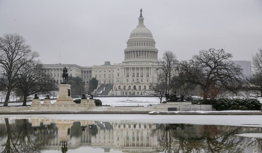 The Capitol is seen as the negotiations to end the monthlong partial government shutdown remain stalled, in Washington, Friday, Jan. 18, 2019. (AP Photo/J. Scott Applewhite)