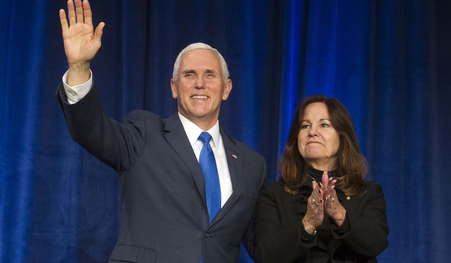 Vice President Mike Pence and his wife Karen acknowledge the audience at the 2019 March for Life dinner in Washington, Friday, Jan. 18, 2019. (AP Photo/Cliff Owen)
