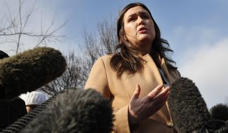 White House press secretary Sarah Huckabee Sanders speaks to the media outside the White House, Friday, Jan. 18, 2019, in Washington. (AP Photo/Jacquelyn Martin)