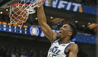 Utah Jazz guard Donovan Mitchell (45) dunks on the Cleveland Cavaliers during the first half in an NBA basketball game Friday, Jan. 18, 2019, in Salt lake City. (AP Photo/Rick Bowmer)