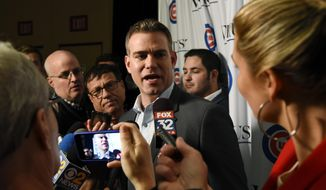 Theo Epstein, Chicago Cubs president of baseball operations talks with reporters during the team's annual convention Friday, Jan. 18, 2019, in Chicago. (AP Photo/Matt Marton)