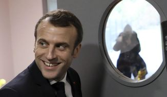 "French President Emmanuel Macron arrives to visit a school in Saint-Sozy, southwestern France, ahead of his meeting with about 600 mayors and local officials in Souillac as part of a national ""grand debate"". (Ludovic Marin/Pool Photo via AP)"