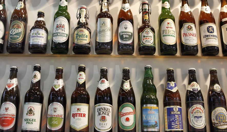 In this Saturday, Jan. 19, 2008, file photo, various bottles of beer are displayed at the agricultural fair 'International Green Week' in Berlin, Germany. Two German brewers associations announced that they are recommending that their members start printing the number of calories contained in their beers and shandies on the label. (AP Photo/Michael Sohn)