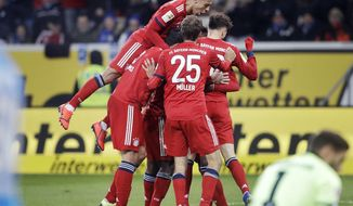 Munich players celebrate their side's second goal during a German Bundesliga soccer match between TSG 1899 Hoffenheim and Bayern Munich in Sinsheim, Germany, Friday, Jan. 18, 2019. (AP Photo/Michael Probst)