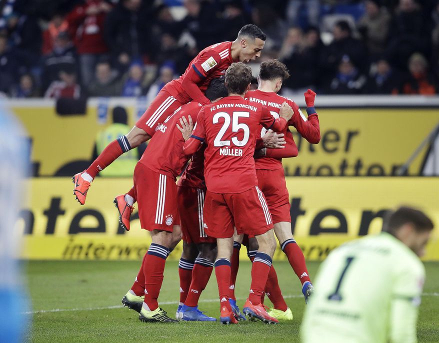 Munich players celebrate their side's second goal during a German Bundesliga soccer match between TSG 1899 Hoffenheim and Bayern Munich in Sinsheim, Germany, Friday, Jan. 18, 2019. (AP Photo/Michael Probst)