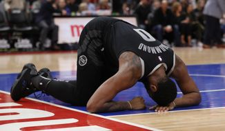 Detroit Pistons center Andre Drummond recovers from a hit to the face during the first half of an NBA basketball game against the Miami Heat, Friday, Jan. 18, 2019, in Detroit. (AP Photo/Carlos Osorio)