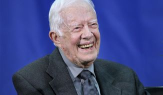 File-This Sept. 12, 2018, file photo shows former President Jimmy Carter, 93, answering questions from students during his annual town hall with Emory University in Atlanta. Carter said Friday, jan. 18, 2019, that he believes President Donald Trump would benefit from a few behind-the-scenes advisers who could help improve U.S. relations with China. (Curtis Compton/Atlanta Journal-Constitution via AP, File)/Atlanta Journal-Constitution via AP)