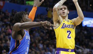 Los Angeles Lakers guard Lonzo Ball (2) shoots as Oklahoma City Thunder forward Jerami Grant defends during the first half of an NBA basketball game in Oklahoma City, Thursday, Jan. 17, 2019. (AP Photo/Sue Ogrocki)