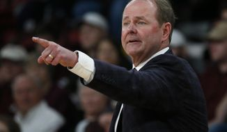 In this Jan. 12, 2019, photo, Mississippi basketball coach Kermit Davis directs team floor action in a NCAA college basketball game against in-state rival, Mississippi State, in Starkville, Miss. The coaching comeback of Davis is a tale three decades in the making and as Mississippi's first-year coach has the Rebels back in the AP Top 25 for the first time since 2013. (AP Photo/Rogelio V. Solis)