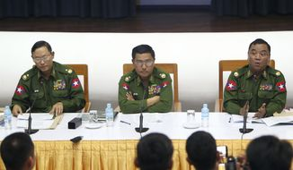 Maj. Gen.Nyi Nyi Tun, vice chairman of the Myanmar's military information committee, left, Maj. Gen. Soe Naing Oo, chairman of the Myanmar's military information committee, center, and Brig. Zaw Min Tun, secretary of the Myanmar's military information committee, attend a press conference at the Military Museum in Naypyitaw, Myanmar, Friday, Jan. 18, 2019. (AP Photo/Aung Shine Oo)