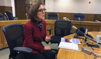 Oregon Gov. Kate Brown speaks at the Associated Press legislative preview, Friday, Jan. 18, 2019 in Salem, Ore.. She said boosting funding for public education is her top priority heading into the 2019 Legislature. (AP Photo/Andrew Selsky)