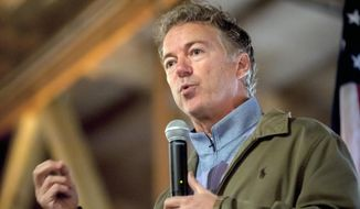 "FILE - In this Nov. 5, 2018 file photo, U.S. Sen. Rand Paul, R-Ky., speaks at a Republican Party rally at Highland Stables in Bowling Green, Ky.  Paul's attorneys say the Republican lawmaker's political views should be off-limits at his upcoming civil trial against his neighbor. The attorneys say his political beliefs could ""alienate"" potential jurors who don't share his views. The senator's legal team filed a motion asking a Kentucky judge to exclude any references to Paul's political views and the condition of his yard. The civil trial stems from a 2017 attack when Paul was tackled by Rene Boucher while doing yard work. (Bac Totrong/Daily News via AP, File)"