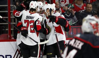 The Ottawa Senators celebrate a goal by Bobby Ryan during the second period of an NHL hockey game against the Carolina Hurricanes, Friday, Jan. 18, 2019, in Raleigh, N.C. (AP Photo/Karl B DeBlaker)