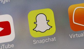 This Wednesday, Aug. 9, 2017, file photo shows the Snapchat app.  (AP Photo/Richard Drew, File) **FILE**