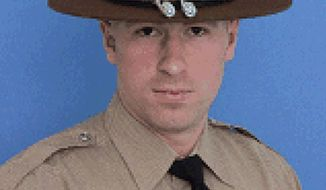 This undated photo provided by the Illinois State Police shows Trooper Christopher Lambert. Funeral services for Lambert are planned for Friday, morning, Jan. 18, 2019, at Willow Creek Community Church in South Barrington, Ill. Lambert was killed when he was struck by a vehicle along Interstate 294 in suburban Chicago during a snowstorm on Saturday, Jan. 12, 2019, near Northbrook, Ill. (Illinois State Police via AP)