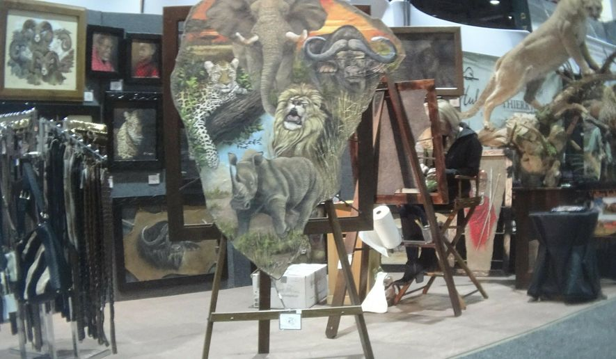 This image provided by the Humane Society of the United States shows a painting on elephant hide for sale at the Safari Club International conference in Reno, Nev., on Jan. 9, 2019. Photos and video taken by animal welfare activists show an array of potentially illicit products crafted from the body parts of threatened big-game animals, including boots, chaps, belts and furniture labeled as elephant leather. The artist told the activists on a video they recorded that the painting was on elephant hide. (Humane Society of the United States via AP)