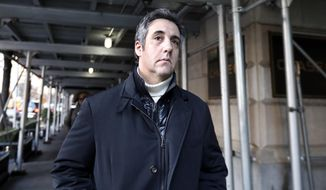 Michael Cohen, former lawyer to President Donald Trump, leaves his apartment building in New York. (AP Photo/Richard Drew, File)