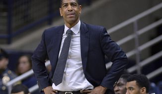 FILE - In this Feb. 7, 2018, file photo, Connecticut head coach Kevin Ollie watches from the sideline during the first half an NCAA college basketball game in Storrs, Conn. The University of Connecticut has announced it is self-imposing penalties, including the loss of a scholarship for the 2019-20 season, for violations of NCAA rules under former basketball coach Kevin Ollie, Friday, Jan. 18, 2019. The school said it also will restrict its recruiting and pay a fine of $5,000.(AP Photo/Jessica Hill, File)
