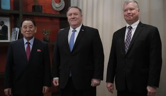 Secretary of State Mike Pompeo, center, Kim Yong Chol, a North Korean senior ruling party official and former intelligence chief, left, and U.S. Special Representative for North Korea, Stephen Biegun, right, meet in Washington, Friday, Jan. 18, 2019. (AP Photo/Carolyn Kaster)