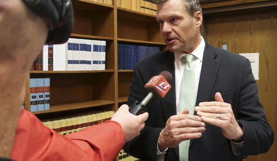 FILE - In this Nov. 30 2018 file photo, former Kansas Secretary of State Kris Kobach answers questions from reporters in Topeka, Kan. The future of a contentious multi-state voter registration database is uncertain now that former Kansas Secretary of State Kobach no longer holds that office. A spokeswoman for Kansas Secretary of State Scott Schwab said Friday, Jan. 18, 2019, the office is reviewing Interstate Voter Registration Crosscheck Program and consulting with other member states. (AP Photo/John Hanna File)