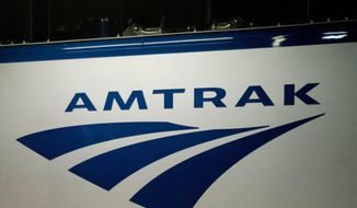 In this Feb. 6, 2014, file photo, an Amtrak logo is seen on a train at 30th Street Station in Philadelphia. (AP Photo/Matt Rourke, File)