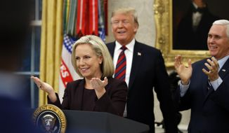 President Donald Trump and Vice President Mike Pence, right, smile after Homeland Security Secretary Kirstjen Nielsen performed the oath of allegiance during a naturalization ceremony in the Oval Office of the White House, in Washington, Saturday, Jan. 19, 2019. (AP Photo/Alex Brandon)