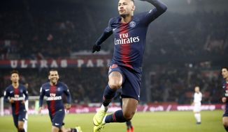 PSG's Neymar celebrates after scoring the opening goal during the League One soccer match between Paris Saint Germain and Guingamp at the Parc des Princes stadium in Paris, Saturday, Jan. 19, 2019. (AP Photo/Michel Euler)