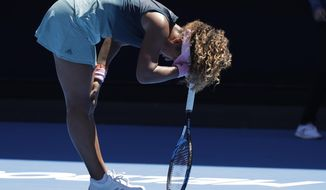 Japan's Naomi Osaka rests on her racket during her third round match against Taiwan's Hsieh Su-Wei at the Australian Open tennis championships in Melbourne, Australia, Saturday, Jan. 19, 2019. (AP Photo/Kin Cheung)