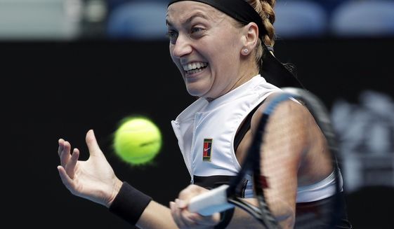 Petra Kvitova of the Czech Republic makes a forehand return to United States's Amanda Anisimova during their fourth round match at the Australian Open tennis championships in Melbourne, Australia, Sunday, Jan. 20, 2019. (AP Photo/Aaron Favila)