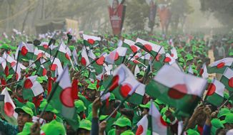 Supporters wave Awami League political party flags during a rally celebrating the party's overwhelming victory in last month's election in Dhaka, Bangladesh, Saturday, Jan. 19, 2019. (AP Photo)