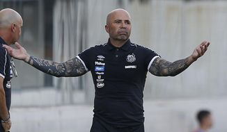 Jorge Sampaoli, coach of Santos, reacts during a Sao Paulo Soccer league championship match against Ferroviaria in Santos, Brazil, Saturday, Jan. 19, 2019. It's the first match of the coach Sampaoli, of Argentina, as head of the legendary Santos Soccer team. (AP Photo/Nelson Antoine)