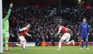 Arsenal's Laurent Koscielny, second right celebrates after scoring his sides2nd goal during the English Premier League soccer match between Arsenal and Chelsea at the Emirates stadium in London, Saturday, Jan. 19, 2019. (AP Photo/Frank Augstein)