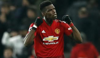 Manchester United's Paul Pogba celebrates after the final whistle of the English Premier League soccer match between Manchester United and Brighton at Old Trafford, Manchester, England, Saturday, Jan. 19, 2019. (Martin Rickett/PA via AP)
