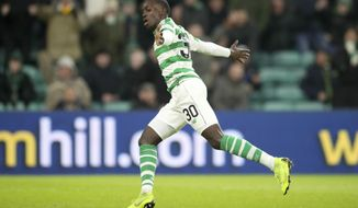 Celtic's Tim Weah celebrates scoring his side's third goal during the Scottish Cup fourth round match at Celtic Park, Glasgow, Saturday, Jan.19, 2019. Weah, the U.S. striker and son of former AC Milan star George Weah, scored on his debut for Celtic in the Scottish Cup. (Jane Barlow/PA via AP)