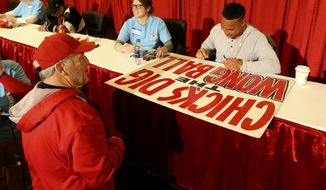 "Longtime Cardinal fan ""Mr. Sign Guy"" Marty Prather, of Springfield, Mo., has St. Louis Cardinals' Kolten Wong autograph his Wong sign at Cardinals Care Winter Warm-Up on Saturday, Jan. 19, 2019, in St. Louis, Mo. (Laurie Skrivan,/St. Louis Post-Dispatch via AP)"