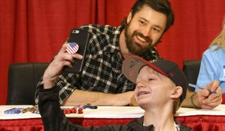 Dylan Howard, 13, of Phoenix, Ariz., snaps a selfie with St. Louis Cardinals' Andrew Miller after getting his autograph at the Cardinals Care Winter Warm-Up on Saturday, Jan. 19, 2019, in St. Louis, Mo. (Laurie Skrivan,/St. Louis Post-Dispatch via AP)