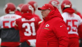 Kansas City Chiefs head coach Andy Reid watches workouts Thursday, Jan. 17, 2019, in Kansas City, Mo. The Chiefs host the New England Patriots in the NFL 's AFC football championship game on Sunday. (AP Photo/Charlie Riedel)