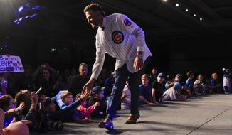 Chicago Cubs' Kris Bryant works the crowd during the team's annual convention Friday, Jan. 18, 2019, in Chicago. (AP Photo/Matt Marton)