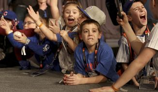 Young fans react as players appear during the Chicago Cubs' annual fan convention in Chicago on Friday Jan. 18, 2019. (Patrick Kunzer/Daily Herald via AP)