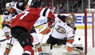 A shot by New Jersey Devils center Pavel Zacha (37), of the Czech Republic, gets by Anaheim Ducks goaltender John Gibson (36) but does not enter the goal during the second period of an NHL hockey game, Saturday, Jan. 19, 2019, in Newark, N.J. (AP Photo/Julio Cortez)