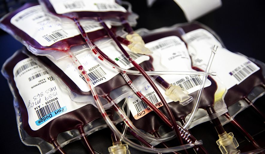 In this Thursday, Jan. 10, 2019 photo, bags of donated blood ready for final labels to be affixed are displayed in LifeServe Blood Center's lab in Des Moine, Iowa. (Kelsey Kremer/The Des Moines Register via AP)