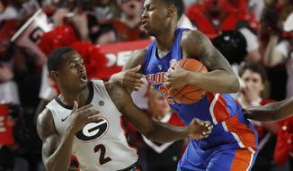 Florida forward Keith Stone (25) steals the ball from Georgia guard Jordan Harris (2) during an NCAA college basketball game in Athens, Ga., on Saturday, Jan. 19, 2019. ( Joshua L. Jones/Athens Banner-Herald via AP)