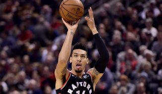 Toronto Raptors guard Danny Green (14) makes a shot during the first half  of an NBA basketball game against the Memphis Grizzlies in Toronto on Saturday, Jan. 19, 2019. (Frank Gunn/The Canadian Press via AP