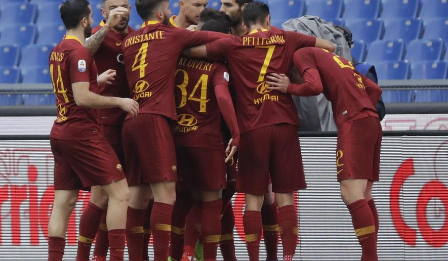 Roma players celebrate after Nicolo' Zaniolo scored their side's opening goal during a Serie A soccer match between Roma and Torino, at the Rome Olympic Stadium, Saturday, Jan. 19, 2019. (AP Photo/Andrew Medichini)