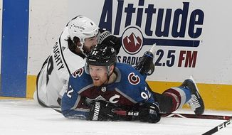 Colorado Avalanche left wing Gabriel Landeskog, right, gets tangled up with Los Angeles Kings defenseman Drew Doughty in the first period of an NHL hockey game Saturday, Jan. 19, 2019, in Denver. (AP Photo/David Zalubowski)