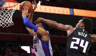 Sacramento Kings guard Buddy Hield (24) fouls Detroit Pistons guard Kalin Lucas (6) during the first half of an NBA basketball game in Detroit, Saturday, Jan. 19, 2019. (AP Photo/Paul Sancya)