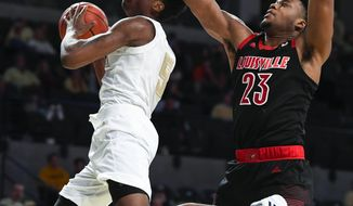 Georgia Tech forward Moses Wright looks to the basket as Louisville center Steven Enoch (23) defends during the second half of an NCAA college basketball game Saturday, Jan. 19, 2019, in Atlanta. Louisville won 79-51. (AP Photo/John Amis)
